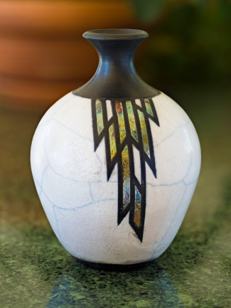 Raku bottle with white crackle glaze.