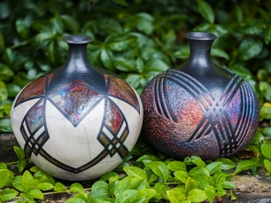 These raku bottles show distinctive designs and different glaze combinations.